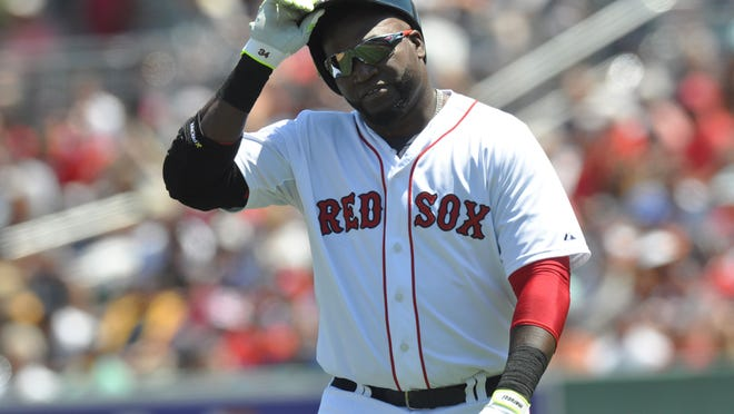 David Ortiz, of the Boston Red Sox, walks back to the dugout after an at bat during a game against the Tampa Bay Rays.Ortiz is retiring after the 2016 season. There is plenty of Ortiz merchandise available in the gift shop at JetBlue Park in Fort Myers.