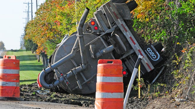A manure truck rolls over at the intersection of UU and Tower Rd., East of Fond du Lac, on Tuesday, Oct. 4, 2011. Reporter photo by Aileen Andrews
