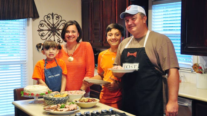 From left: Taylor, Michelle, Jackson and Ronnie Prince. Ronnie came from a long line of good cooks and has even compiled a collection of recipes in his book, 'Prince Family and Friends Cookbook.'