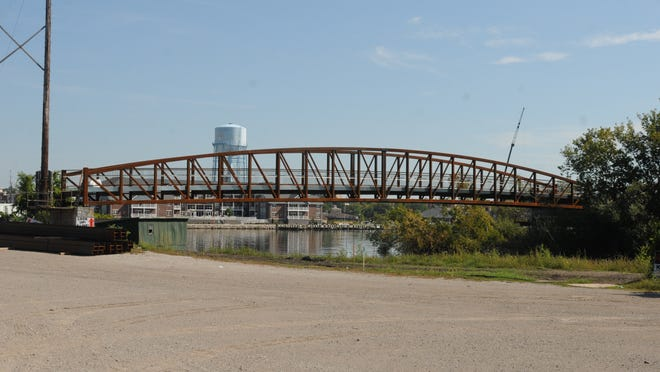 A section of the old 1899 CN railroad bridge that used to span the Fox River in Oshkosh is getting new life connecting across a lagoon on the Boat Works property as part of a river walk connection on the south side of the Fox River.