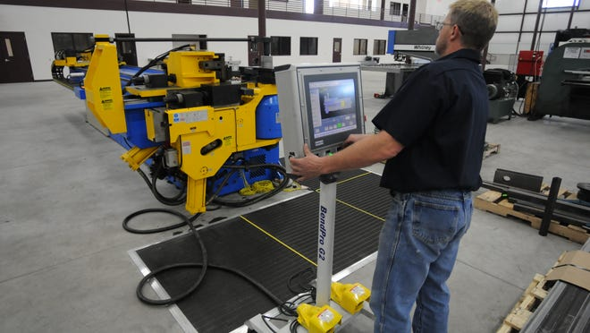 Dave Buskirk operates a tube bender at Jay Manufacturing on West 20th Ave. in Oshkosh.
