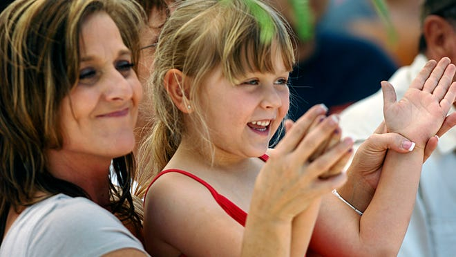 Juliana Henderson, 5, and her mom, Dawn Henderson, enjoy the 2011 Scratch Ankle Festival. The Milton festival has been rescheduled for April 17 because of the potential for threatening weather.