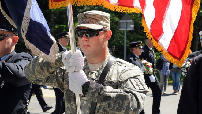 Pfc. Eric Pfeiffer of Rinebeck, serving with the National Guard, walks in the Memorial Day parade May 27, 2013 in Rhinebeck.