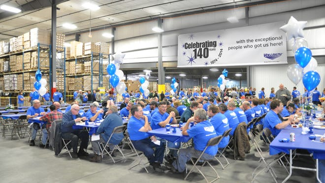 File - Employees of Vollrath Co. celebrate the company's 140th anniversary in 2014.