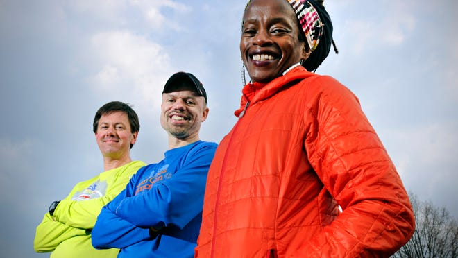Runners Steve Fines, (left to right) Curt Karolus and Eddah Mutua are three of the local runners going to compete in the Boston Marathon. They got together Saturdayto prepare.