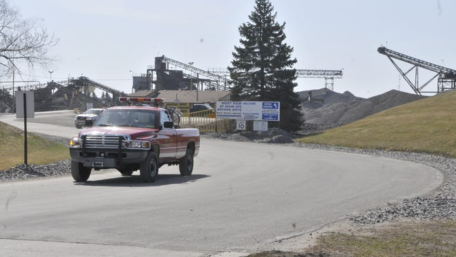 A Waite Park Fire Department truck drives away from the Martin Marietta site in Waite Park on Sunday morning. An overnight fire at the site brought in several fire departments and a hazmat team.