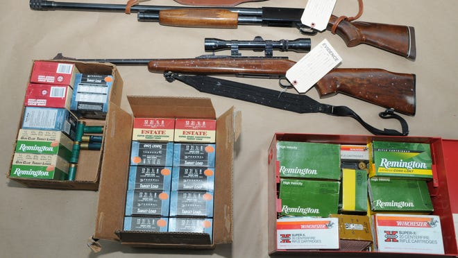 Two of the 11 rifles and boxes of ammunition found inside the New City home of Vincent Cordaro, 57, who was fatally shot by a Clarkstown police officer after Cordaro barricaded himself inside and shot at police.