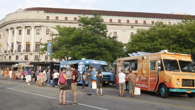 Food trucks line Main Street near Jazz Street at the Xerox Rochester International Jazz Festival in 2014.
