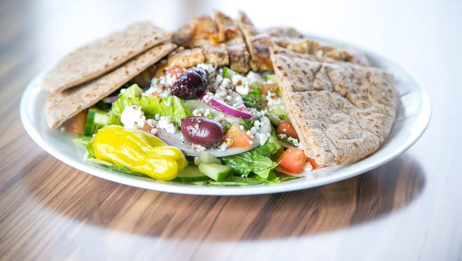 The Greek Salad with chicken and wheat pita at Mika's Greek restaurant in Tempe on September 10, 2015.