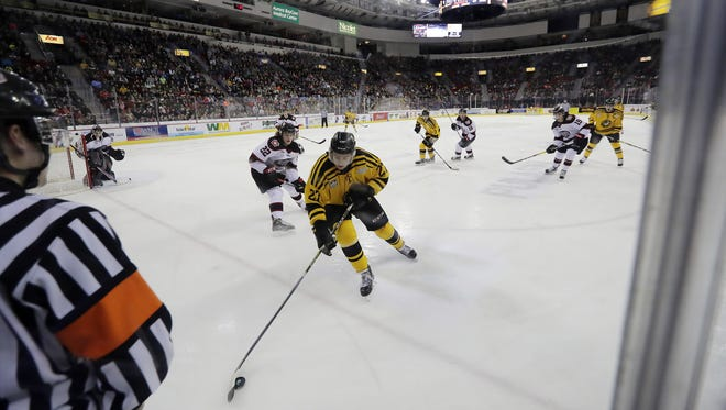 Green Bay Gamblers forward Josh Kosack (27) chases down the puck against the Chicago Steel at the Resch Center on Feb. 25 in Ashwaubenon. The Gamblers drew a season-high 7,619 fans for its 18th annual Teddy Bear Toss game.