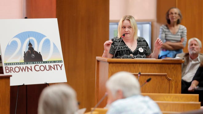 Wendy Coriell speaks in favor of putting a question about the legality of marijuana on the Nov. ballot at a Brown County board meeting at city hall on Wednesday, July 18, 2018 in Green Bay, Wis. Members of the public spoke to the county board Wednesday as it weighed whether or not election ballots this fall will include non-binding questions about the legality of marijuana. Adam Wesley/USA TODAY NETWORK-Wisconsin