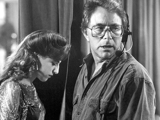 Mayim Bialik and director Bill Bixby on the set of