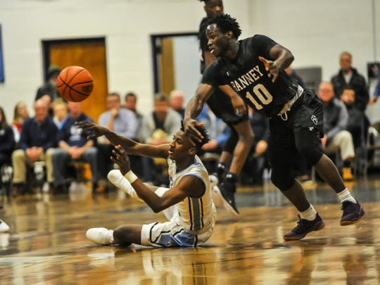 Jamir Watkins of Mater Dei Prep, left and Ahmadu Sarnor of the Ranney School, right, fight for the loose ball in a game on Feb. 5 in Middletown.