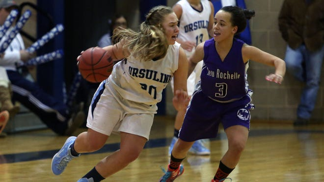 From left, Ursuline's Casey Friend (30) drives around New Rochelle's Kayla Correa (3) during a girls basketball game at Ursuline High School in New Rochelle Jan. 21, 2015. Ursuline won the game 53-46.