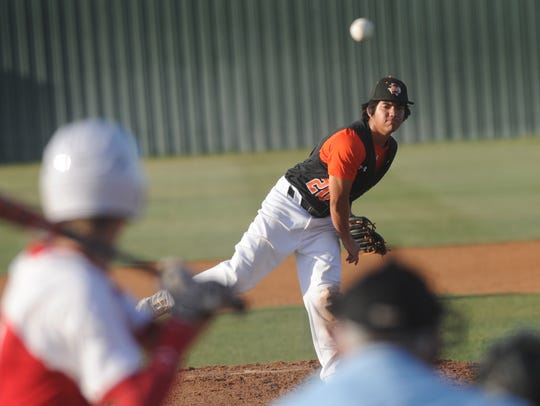 Ira pitcher Anthony Coy throws a pitch to a Baird batter
