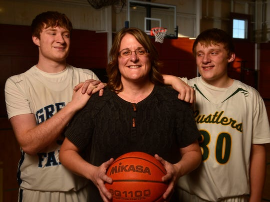 Former Lady Griz great Marti (Kinzler) Vining and her sons Lukas, left, and Sam.