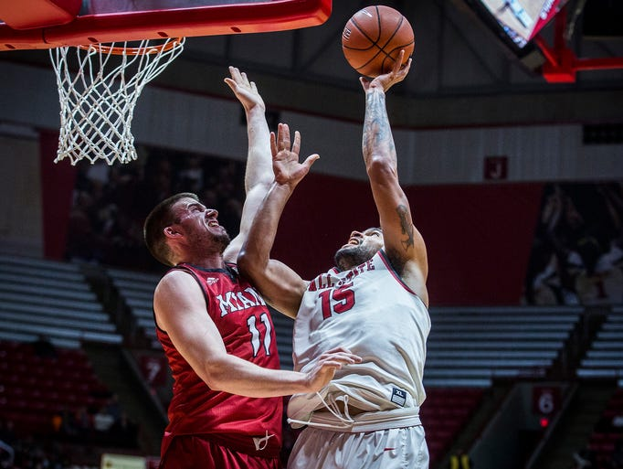 Ball State's Franko House fights for a shot past Miami's