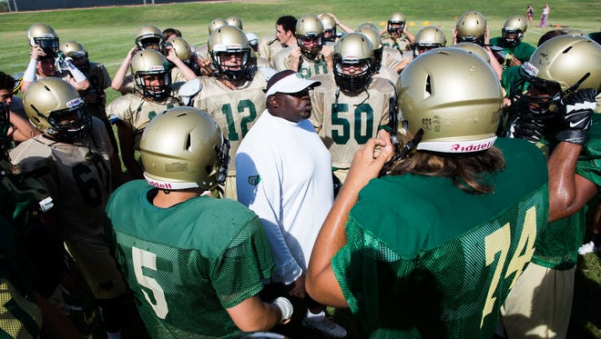 Head coach Gerald Todd talks with the team during football practice at Basha High School in Chandler, AZ, on Thursday, July 30, 2015.