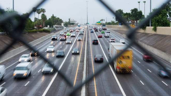 Traffic flows along I-17 south of downtown Phoenix on Friday, July 31, 2015.