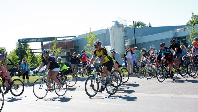 Several hundred cyclists participated in the Ride of Silence taking place at Arcadia Brewing Co. in Kalamazoo Wednesday evening, June 8, 2016 in honor of those who lost their lives and were injured in Tuesday's events.