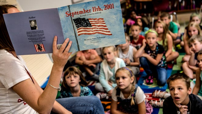 Kelsey Griley, a second grade teacher at McGuffey Elementary, reads a book about September 11th to her students. Afterwards she answered questions the kids had about the terrorist attacks.