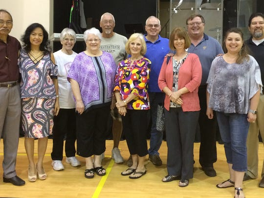 Members of the First United Methodist Church Abilene Missions Committee meet at the Oct. 1 Missions Sunday Celebration. Front row, from left: co-chairs Manolo Z. Cabasal and Mary T. Cabasal, secretary Jane Spraberry and members Carol Davis, Holly Irvin and Amy Bela. Back row: members Janet Klies, Don Klies, Randy Davis, Guy Irvin and Pastor Gilbert Bela.
