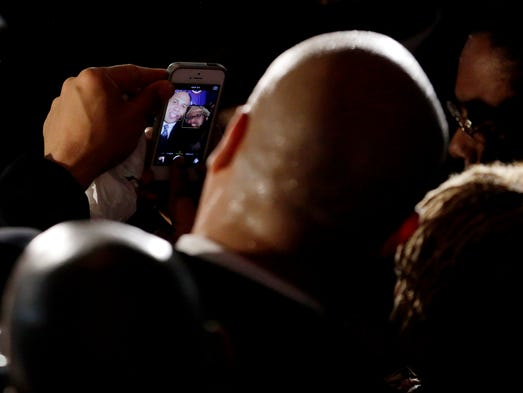 Sen. Cory Booker, D-N.J., left, poses for a photograph