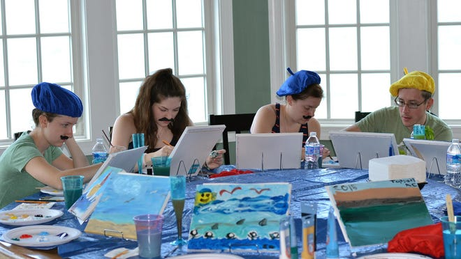 """Nicole Nussbaum, Katie Pollack, Kristen Nussbaum and Robert Nussbaum paint vacation scenes as part of an """"Easel Like Sunday Morning"""" theme at a vacation home in North Topsail Beach, N.C."""