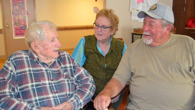 Milton Long, 98, talks old times with his daughter, Deb Long, and friend Daniel Stubbins from South Carolina.
