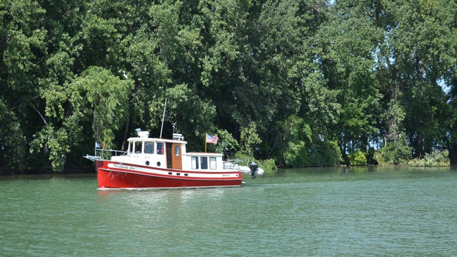Boaters return to Port Clinton from morning excursions on the lake Sept. 7. Lake Erie fishery managers are asking local anglers to bring their perch catches to the Marblehead scanning station to identify tagged perch. Information from tagged fish will aid in better management of the perch population.