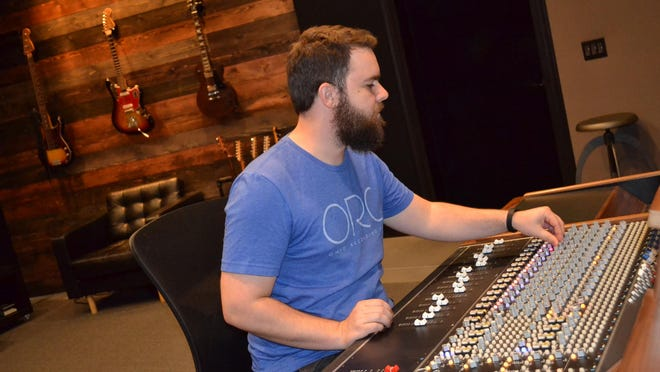 Brennan Willis works in Studio A at the Ohio Recording Co. ORC is one of only two recording studios in Ohio that own a professional API 1608 recording console.