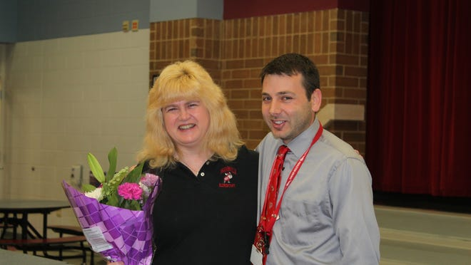 Sharonville Elementary 2014 Viking Excellence of the Year winner Vicki Selm and Principal Jesse Kohls after the announcement of the award.