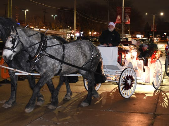 Horse carriage rides were offered to those who attended the Redford Olde-Fashioned Holidays event on Thursday.