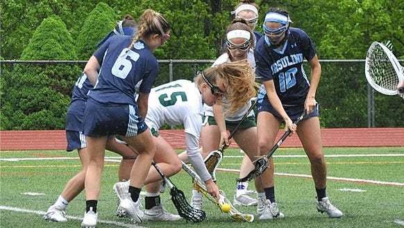 Yorktown's Kelsey McDonnell tries to pick up a loose