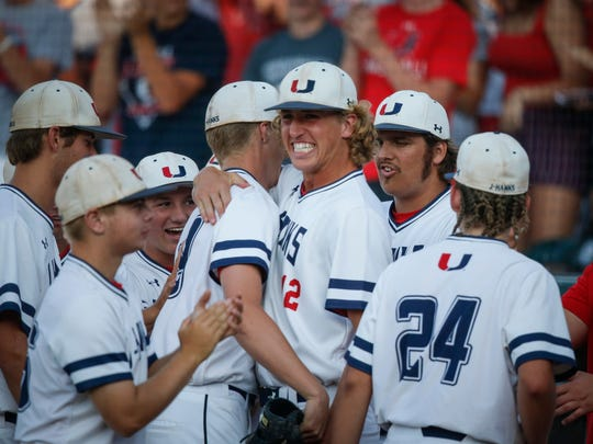 Members of the Urbandale baseball team are all smiles after a 7-3 win over Western Dubuque in Class 4A on Friday, July 27, 2018, at Principal Park in Des Moines.