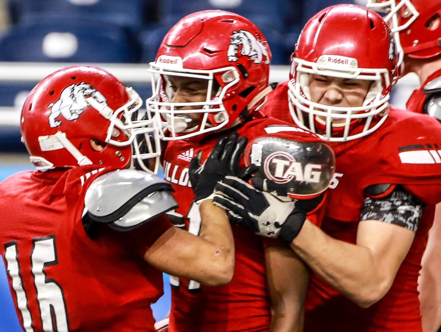 Romeo senior wide receiver Brad Tanner, center, celebrates scoring a touchdown with his teammates during a 41-27 win over Detroit Cass Tech in the Division 1 state championship.
