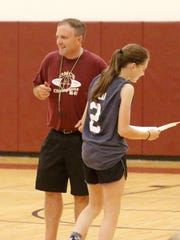 Odessa-Montour girls varsity basketball coach Greg Gavich hands out an award during the final day of the Finger Lakes Boys & Girls Basketball Camp presented by the Shoot the Lights Out Basketball Academy on July 13 at Odessa-Montour High School.