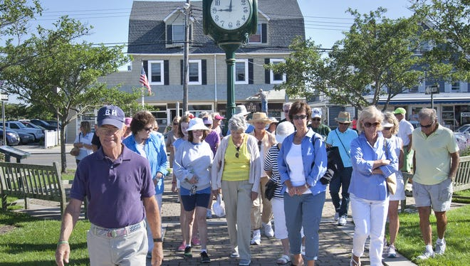 Bay Head mayor William Curtis (left) leads a walking tour of the Bay Head Yacht Club, recently rebuilt after Sandy and the site of the new town hall in 2015.
