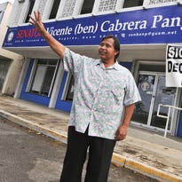 "Late Sen. Vicente ""Ben"" Pangelinan waves to a passing motorist as he is photographed in front of his office in Hagatna on Nov. 22, 2011. Sen. Pangelinan spearheaded efforts to register people for the Decolonization Registry  Pacific Daily News file photo"