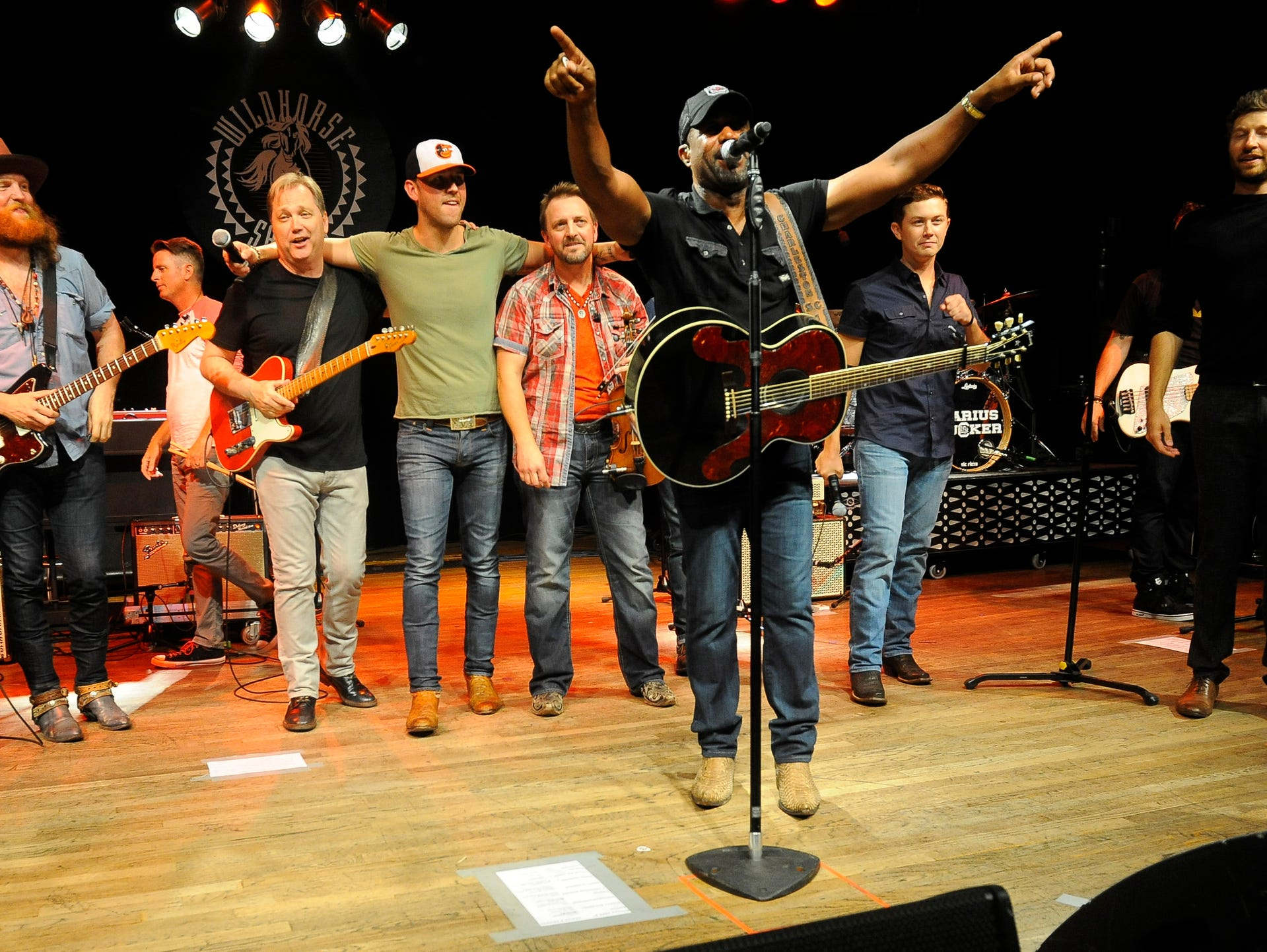 Darius Rucker leads the song 'Wagon Wheel' during his