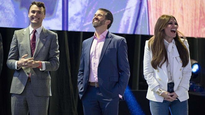 Charlie Kirk, Donald Trump, Jr. and Kimberly Guilfoyle, listen to remarks delivered at Turning Point USA Student Action Summit at the Palm Beach County Convention Center in West Palm Beach, Saturday, Dec. 21, 2019.