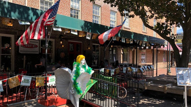 Restaurants across Savannah, including tourism hotspots at City Market, must halve their in-house dining capacity to comply with Mayor Van Johnson's emergency declaration.