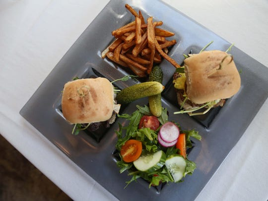 A side salad, burgers and fries at HoQ in the East
