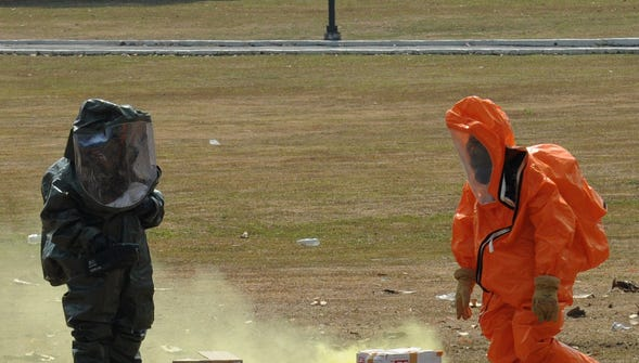 Philippine soldiers in chemical suits rescue victims during a drill for terrorist attacks with chemical and biological weapons.