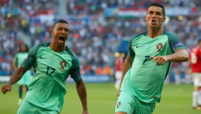 Portugal's Cristiano Ronaldo celebrates with teammate Nani, left, after scoring his side's second goal Wednesday.