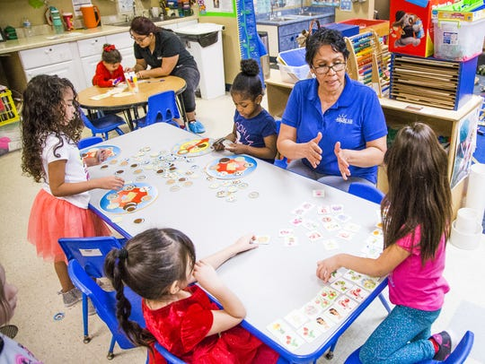 Teacher Rosa Bravo works with her pre-kindergarten