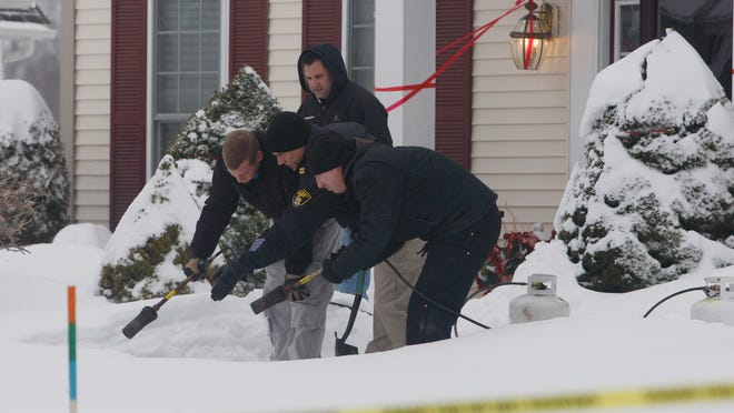 Deputies were looking through the snow for evidence on Tuesday, Feb. 10, 2015, after a fatal shooting in Pittsford. After shoveling for awhile, they used a heater with flame to melt the snow.