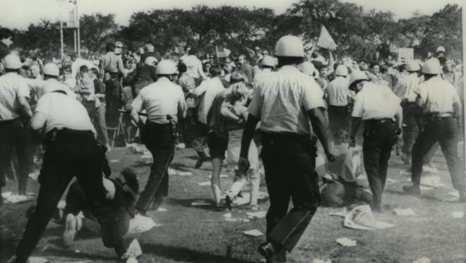 Chicago police officers charge through a crowd of demonstrators as they try to clear Chicago's Grant Park Aug. 28, 1968, during the Democratic National Convention.