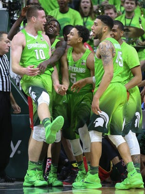 Michigan State's Mean Green jerseys made their debut Saturday.