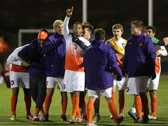 Clemson Tigers Alex Happi (15) celebrates with his teammates after scoring the game winner in overtime against the South Carolina Gamecocks in the second round of the NCAA tournament Sunday at Historic Riggs Field, November 20, 2016.